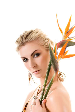 Sexy blonde woman with strelizia flowers isolated on white background photo