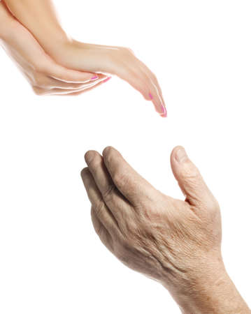 Hands of young woman and elderly man over white background Stock Photo - 2843041