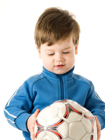 Handsome little boy holding soccer ball isolated on white background photo