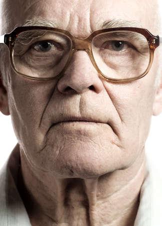 Elderly man with massive glasses
