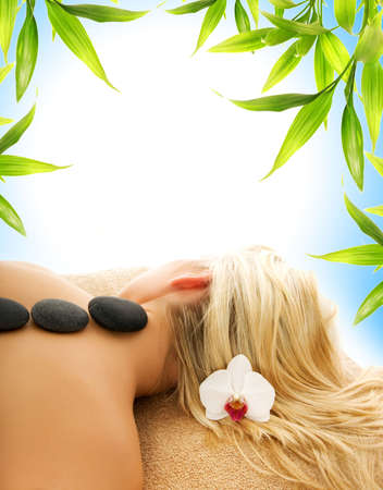 volcanic stones: Massage with hot volcanic stones Stock Photo