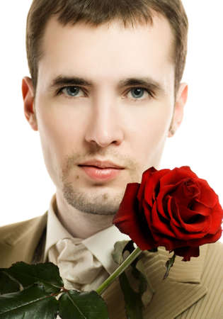 Handsome young man with a rose photo
