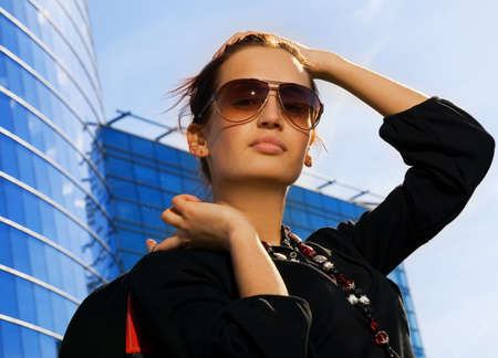 Beautiful young brunette. Modern building behind her Stock Photo - 2930363