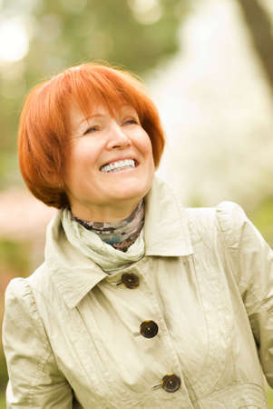 Beautiful smiling middle-aged woman outdoors Stock Photo - 3001687
