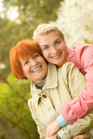 Mother and daughter having fun outdoors photo