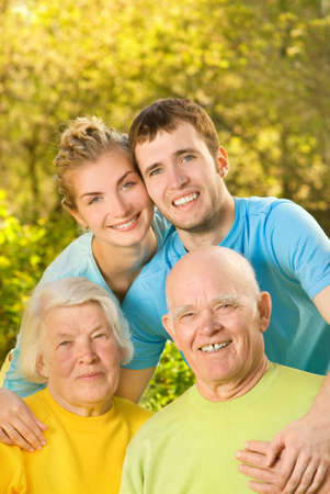 Young couple and their grandparents outdoors Stock Photo