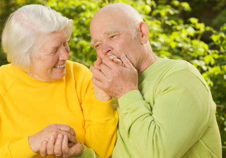 wise woman: Senior couple in love outdoors Stock Photo
