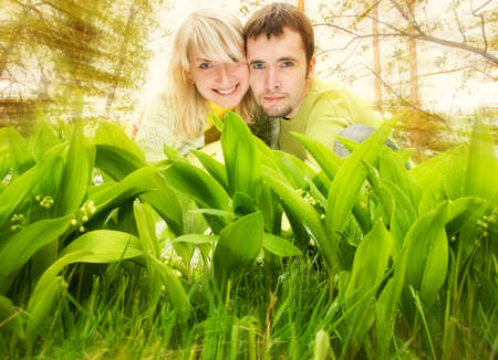 Young couple hiding in fresh green grass Stock Photo - 3061235