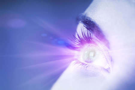 laser surgery: Blue eye with glow effect on it (shallow DoF)