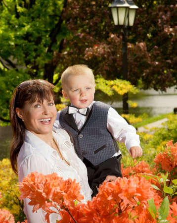 Happy mother with her child outdoors photo