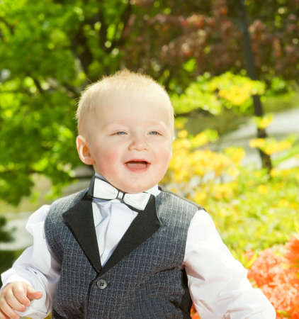 Handsome little boy outdoors photo