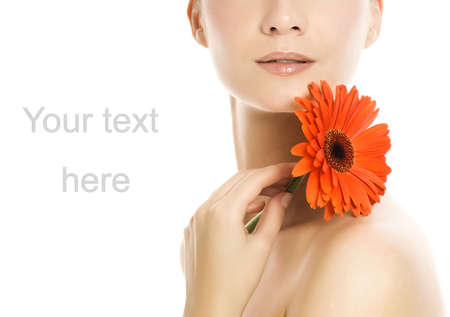 Beautiful young woman with gerber flower Stock Photo - 3091308