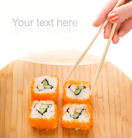 Sushi on a bamboo plate photo