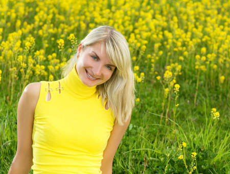 Beautiful young woman in a flower field photo