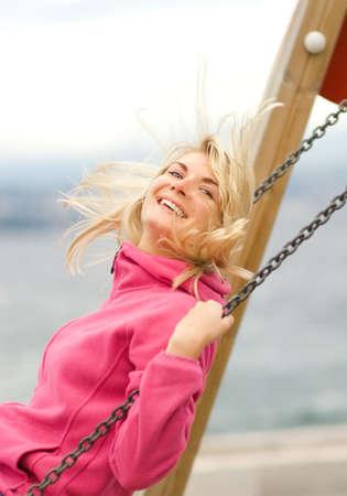 Beautiful young woman having fun outdoors photo