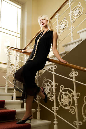 Beautiful young woman standing on a staircase Stock Photo - 3227953