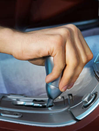 Drivers hand changing speed photo
