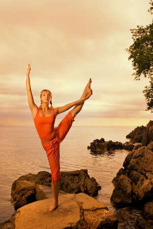 Beautiful young woman doing yoga exercise outdoors Stock Photo - 3243934