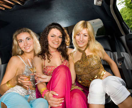Three beautiful women in a limousine photo