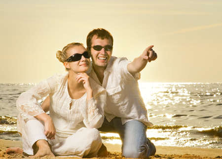Young beautiful couple relaxing on the beach photo