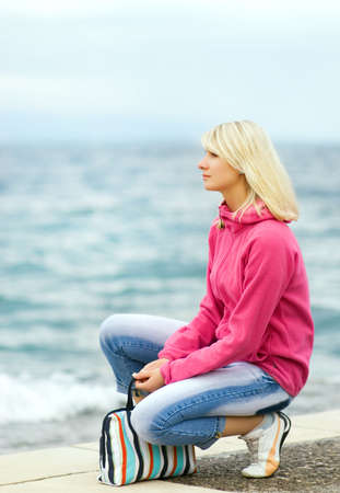 Sad woman sitting near the ocean Stock Photo - 3257323