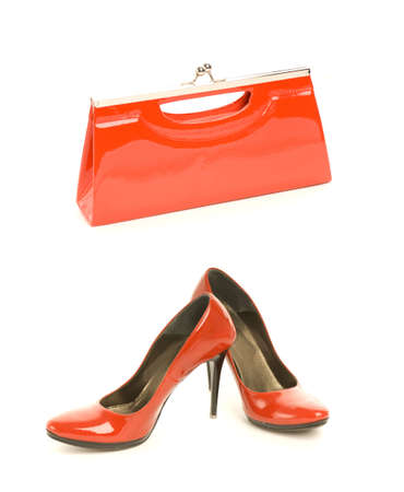 Kit of two classic items, sexy red shoes with high heel and elegant leather handbag Stock Photo - 3329876