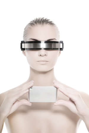 Cyber woman holding silver gadget