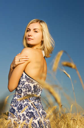 Beautiful woman in the wheat field Stock Photo - 3360512