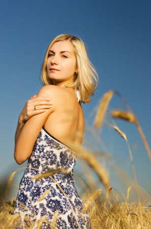 Beautiful woman in the wheat field Stock Photo - 3360512
