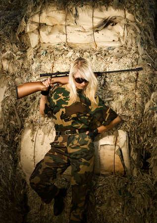 army face: Beautiful woman soldier with a sniper rifle