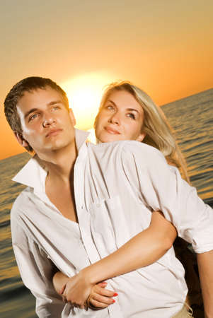 Young couple in love near the ocean at sunset Stock Photo - 3377255