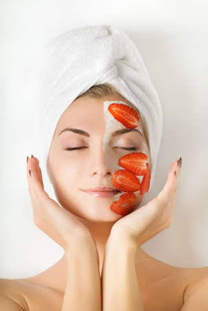 Beautiful woman with fruit mask on her face