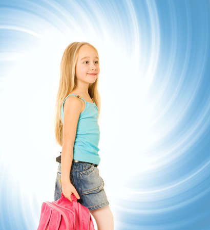 Young girl with a pink backpack over abstact blue background photo