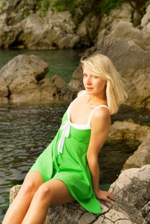 Beautiful young woman relaxing near the ocean photo