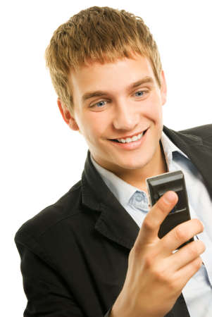 Young happy man holding mobile phone photo