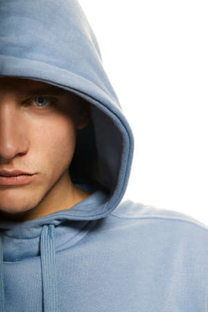 Handsome young man in a hood isolated on white background photo