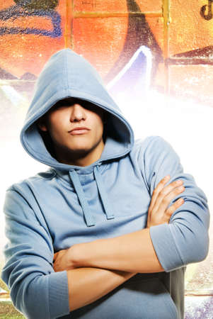 Cool looking man in a hood over abstract graffity background Stock Photo - 3402551