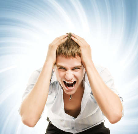 Screaming young handsome man over abstract blue background photo