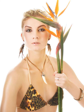 Beautiful woman with exotic flower photo