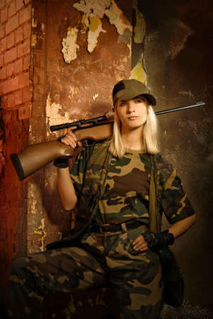 airsoft gun: Beautiful woman soldier with a sniper rifle