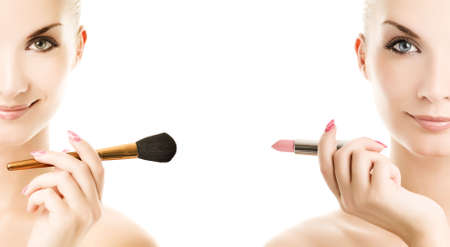 Two beautiful twins holding make-up brush and lipstik. Isolated on white background photo