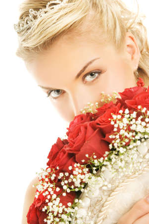 Beautiful bride hiding behind luxury bouquet of roses Stock Photo - 3449149