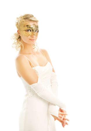 Lovely young lady in a wedding dress and luxury golden carnival mask Stock Photo - 3449140