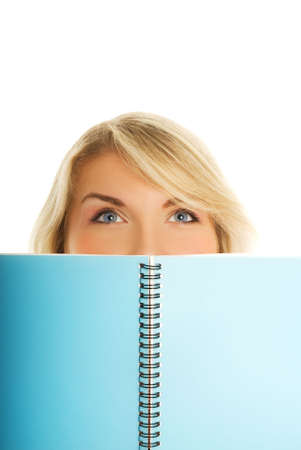 Beautiful student with blue notebook isolated on white background Stock Photo - 3469384