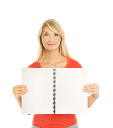 Beautiful student holding open notebook with blank pages photo