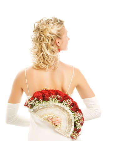 Beautiful young bride with a luxury bouquet of red roses. Isolated on white photo
