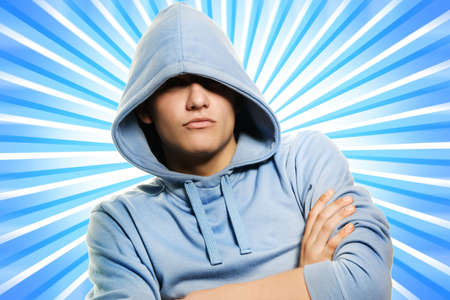 Handsome young man in a hood over abstract blue background Stock Photo - 3479269