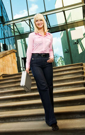 Beautiful business woman near the office building Stock Photo - 3494490
