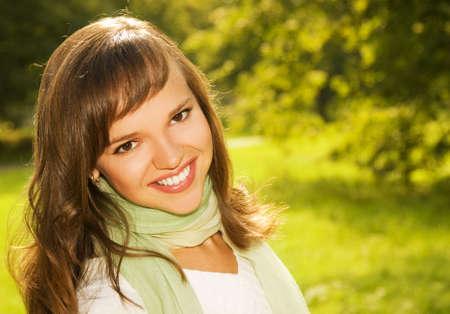 Beautiful  brunette close-up portrait photo