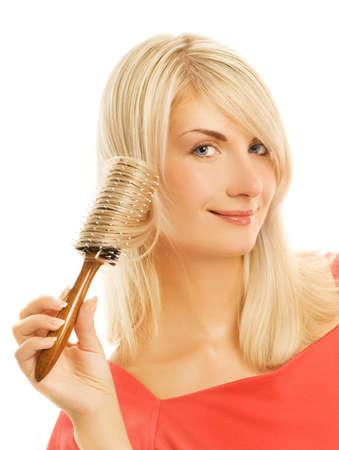 Beautiful young woman combing her hair Stock Photo - 3526912